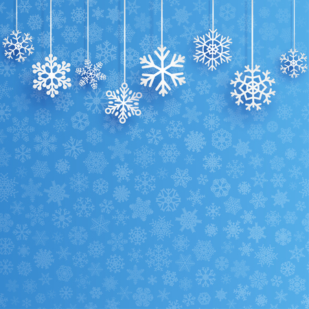 Christmas background with several hanging snowflakes on light blue background of small snowflakes Ilustração
