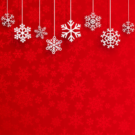 Christmas background with several hanging snowflakes on red background of small snowflakes