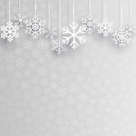 Christmas background with several hanging snowflakes on gray background of small snowflakes Vectores