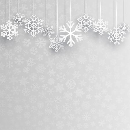 Kerst achtergrond met diverse opknoping sneeuwvlokken op een grijze achtergrond van kleine sneeuwvlokken