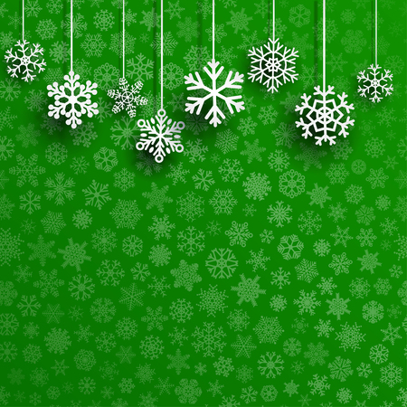 Christmas background with several hanging snowflakes on green background of small snowflakes