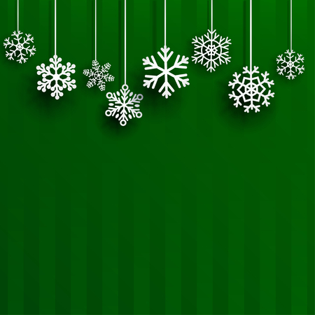 Christmas background with several hanging snowflakes on green striped background