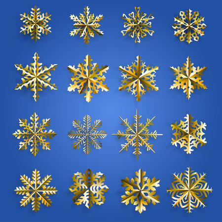 gold snowflakes: Set of gold snowflakes cut out of paper