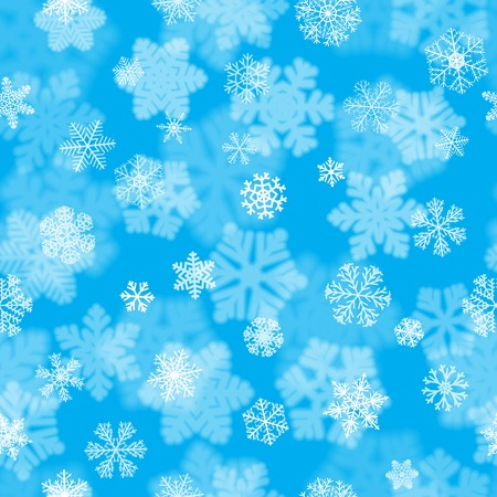 Christmas seamless pattern with white blurred and clear snowflakes on light blue background. Background with snowfall of big and small snowflakes. Christmas vector illustration of beautiful snowflakes