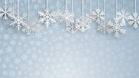 christmas background with big white hanging snowflakes on light blue background of small snowflakes christmas
