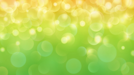 Abstract light background with bokeh effects in green and yellow colors