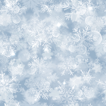Christmas seamless pattern with white blurred snowflakes, glare and sparkles on light blue background