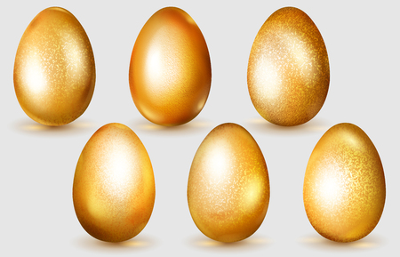 Set of realistic golden Easter eggs with glares and soft shadows on white background