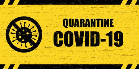 Coronavirus warning sign. Scratched wooden plate with the inscription Quarantine COVID-19 and crossed out virus symbol, black on yellow