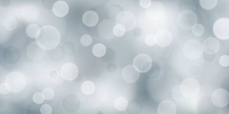 Abstract background with bokeh effects in white and gray colors