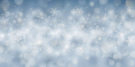 Christmas background of complex big and small falling snowflakes in light blue colors with bokeh effect