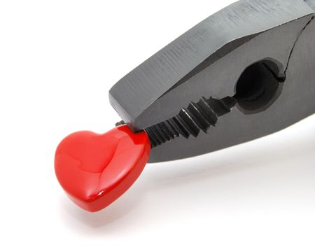 Symbol of heart in black pliers. Over white background