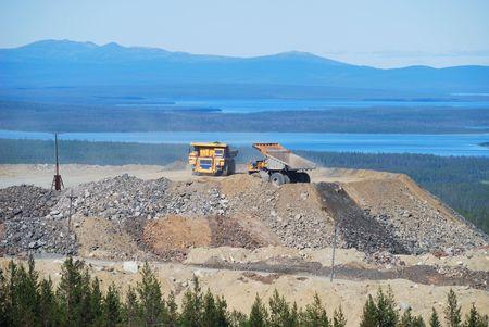 A dump truck unloads stones photo