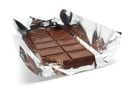 A Bar of chocolate on a aluminum foil Stock Photo
