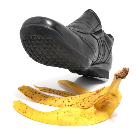 Mans shoe about to step on a banana skin  Stock Photo