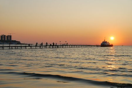 Evening twilight on coast of the black sea photo