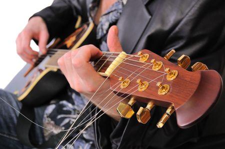 ballad: musician plays his acoustic guitar