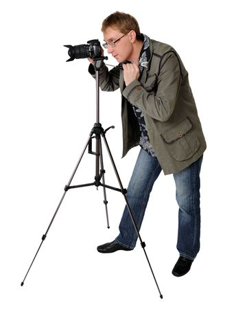 tripod: middle-aged man filming with a semi-professional camera Stock Photo