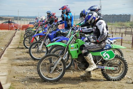 MONCHEGORSK, RUSSIA, JUNE 14: Motorcross racers get ready to start the 2nd stage of the championship race called