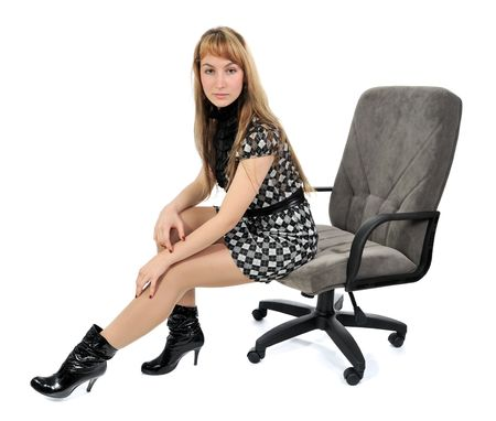 The girl sitting in an armchair. Looking at camera photo