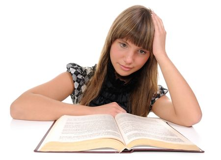 The thoughtful girl looks in the book Stock Photo - 6425078