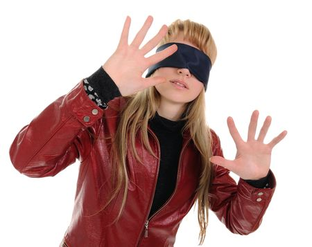 hair tied: Girl blindfolded goes by feel. She is confused and a little afraid