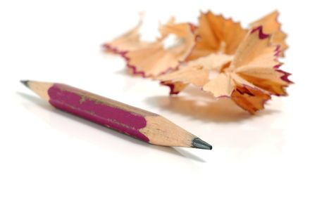 Sharpener and pencil on a white background photo