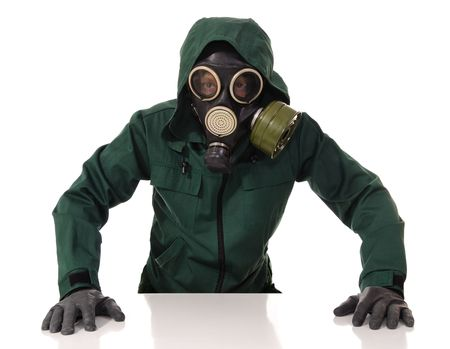 The man in chemical protection suites on a white background. Looking at camera Stock Photo