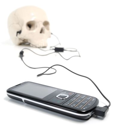 Mobile and skull isolated on white. Stock Photo