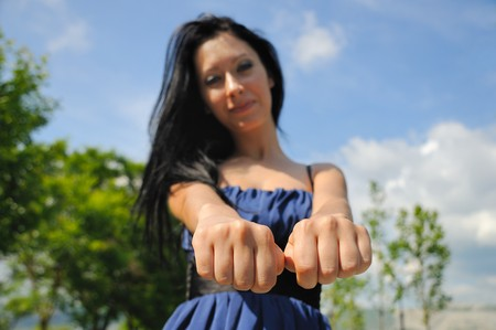 Brunette woman with fists.  Stock Photo