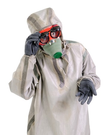 The woman in chemical protection suites on a white background. Looking at camera.  Stock Photo - 7547024