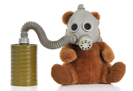 Soft toy bear wear mask as protection against a smoke and a virus.