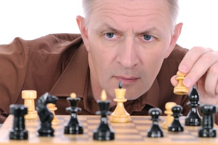 pawn adult: The middle-aged man plays chess. Stock Photo