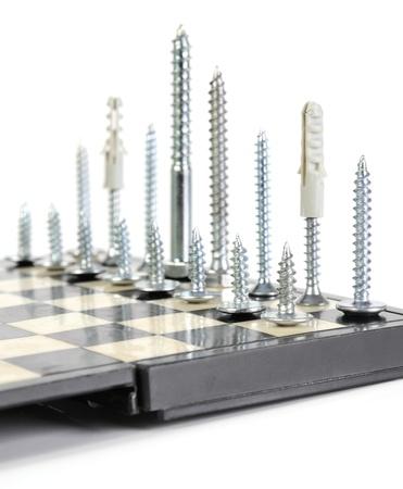 corresponds: New brilliant screws. The order of screws corresponds to chessmen.   Stock Photo