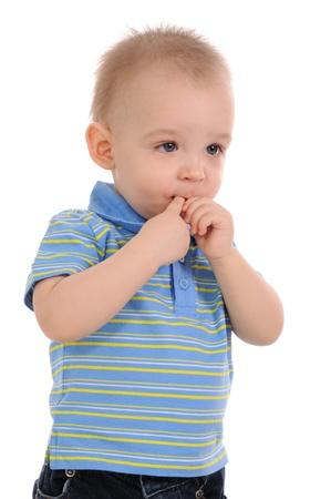 sucks: The amusing kid sucks a finger. On white background