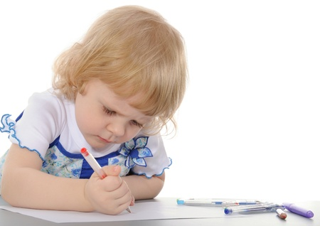 The little girl draws. On a white background. photo
