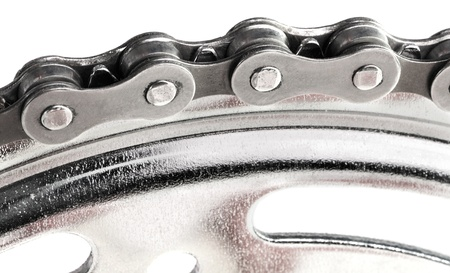 Macro shot of bicycle chain isolated on white. photo