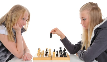 Two blondes playing a game of chess. On a white background Stock Photo