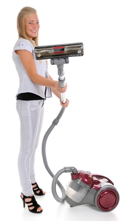 Young woman and vacuum cleaner on a white background photo