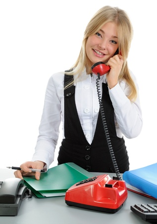 The girl, speaking on phone. On a white background. Stock Photo - 10985393