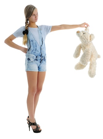 The girl with soft toy bear. isolated on white photo