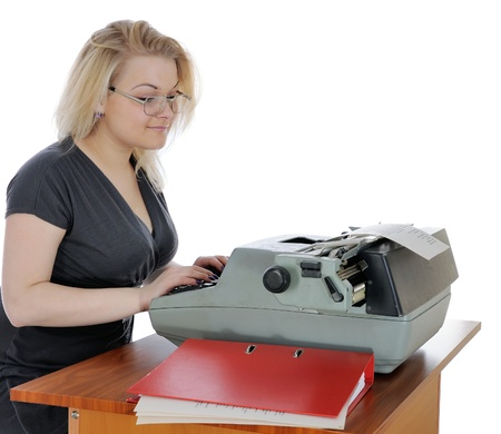 Young woman in eyeglasses with old typewriter. On white background.