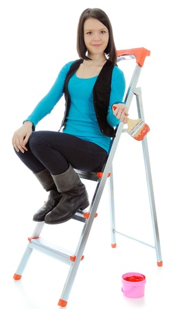 The girl-painter on a step-ladder  On a white background  photo