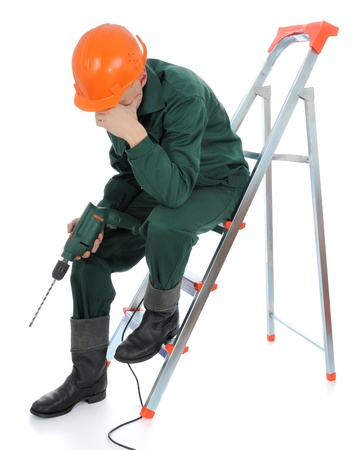 A worker with drill  On white background  photo