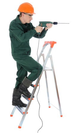A worker with drill, isolated on white  photo