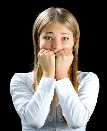 The blonde covering mouth by hands  looking at camera Stock Photo