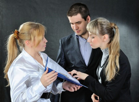 Businesscouple read documents  On a dark background  Stock Photo - 12781823