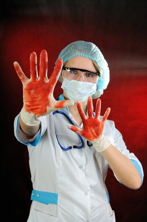 The nurse wearing a dirty gloves  On red background  photo