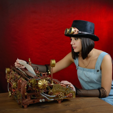 Girl and Steampunk style future Typewriter. Handhome made model. photo