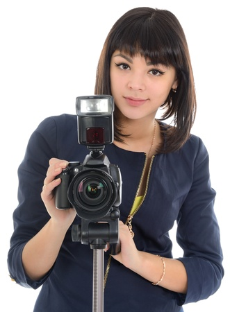 Girl filming with a semi-professional camera, standing on a tripod. photo